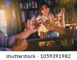 Small photo of Drunk men crank the glass of alcohol at the bar in nightclub, female bartender as background. Selected focus