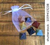 7 pyramid chakra stone crystals ... | Shutterstock . vector #1059415238
