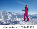 hiker in winter causasus... | Shutterstock . vector #1059442976