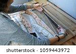 Weaving On A Loom. Closeup...