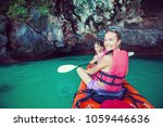women are kayaking in the sea... | Shutterstock . vector #1059446636