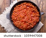 pan of sauce bolognese on... | Shutterstock . vector #1059447008