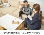handsome young man suffering... | Shutterstock . vector #1059449498