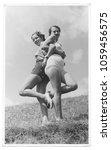 women friends in 1934 | Shutterstock . vector #1059456575