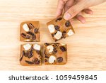 female hand picking blondies... | Shutterstock . vector #1059459845