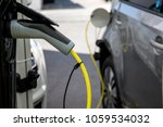 electric car refuel with power | Shutterstock . vector #1059534032