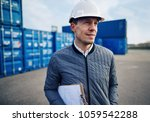 smiling engineer wearing a... | Shutterstock . vector #1059542288