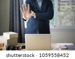 Small photo of Business man Show hand Stop with laptop computer on workingspace