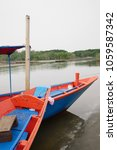 Small photo of The boat parked in the mangrove forest where the floods were the sea monsoon in thailand