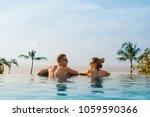 happy couple in infinity pool   Shutterstock . vector #1059590366