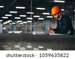 man at a factory with computer | Shutterstock . vector #1059635822