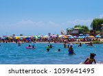 people swimming and enjoy... | Shutterstock . vector #1059641495