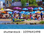people swimming and enjoy... | Shutterstock . vector #1059641498