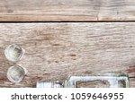 vodka in a bottle on a wooden... | Shutterstock . vector #1059646955
