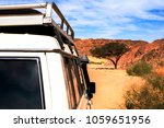 the roof of a white suv ... | Shutterstock . vector #1059651956