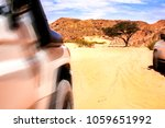 two express suvs are moving in... | Shutterstock . vector #1059651992