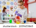 curious experimenter. handsome... | Shutterstock . vector #1059655865