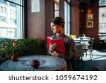 young smiling happy woman in... | Shutterstock . vector #1059674192