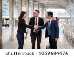 Small photo of Businessman introduce businesswoman for project working