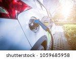 charging an electric car battery | Shutterstock . vector #1059685958