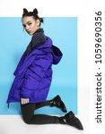 young fashion woman in short... | Shutterstock . vector #1059690356