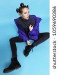 young fashion woman in short... | Shutterstock . vector #1059690386