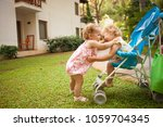 two happy  baby sisters    Shutterstock . vector #1059704345