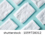 White Spa Towels On Light Blue...