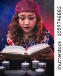 Small photo of Female seer teller fortune doing psychic reading book for predicting fate