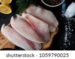 fresh fish fillet with... | Shutterstock . vector #1059790025