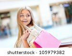smiling girl with shopping bags ... | Shutterstock . vector #105979382