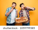 two cheerful men in shirts... | Shutterstock . vector #1059799385