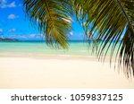 beach in praslin  seychelles   Shutterstock . vector #1059837125