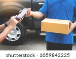 messenger man hold box and talk ... | Shutterstock . vector #1059842225