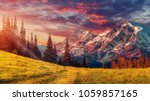Awesome alpine highlands in sunny day. Scenic image of fairy-tale Landscape with colorful sky under sunlit, over the Majestic Rock Mountains. Wild area. Megical Natural Background. Creative image .