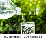 drink water pouring in to glass ... | Shutterstock . vector #1059858965