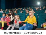 interested girls watching new... | Shutterstock . vector #1059859325