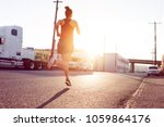 sporty woman running in city... | Shutterstock . vector #1059864176