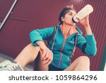 tired woman resting after... | Shutterstock . vector #1059864296