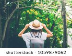 woman in the forest.enjoying... | Shutterstock . vector #1059879062