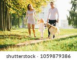 happy family with their dog in... | Shutterstock . vector #1059879386