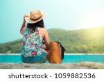 woman sitting on the beach   ... | Shutterstock . vector #1059882536