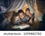 family bedtime. mom and... | Shutterstock . vector #1059882782