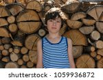portrait of a boy in a striped... | Shutterstock . vector #1059936872