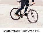 man wearing jeans riding fix... | Shutterstock . vector #1059955148