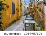 cafe tables and chairs outside... | Shutterstock . vector #1059957806