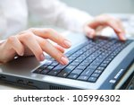 human hands working on laptop... | Shutterstock . vector #105996302