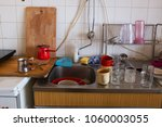regular domestic untidy kitchen ... | Shutterstock . vector #1060003055
