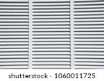 window with white shutters in... | Shutterstock . vector #1060011725