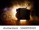 old style movie projector ... | Shutterstock . vector #1060055435